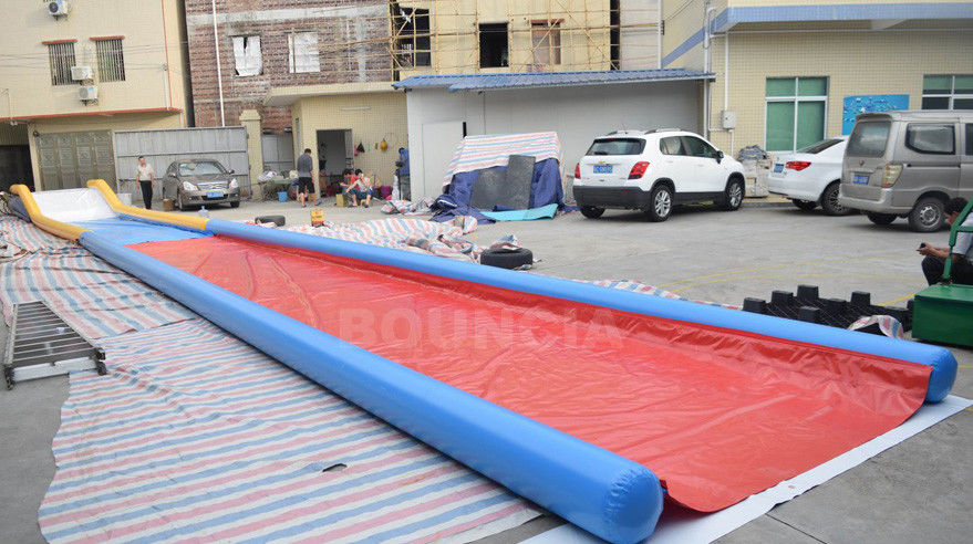 27m Long Air Sealed Inflatable Water Slides For Lakeside / Inflatable Slip N Slide pemasok